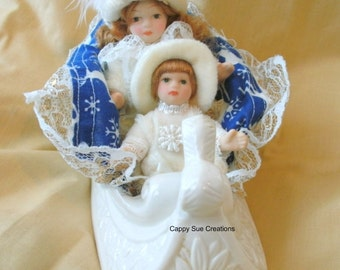 Sleigh ride doll scene one of a kind holiday Christmas or Hanukkah or simply winter decoration