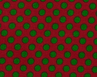 Christmas fabric Christmas green polka dots on red background 100% Cotton Sold as one piece 1 1/3 yards by 44 inches