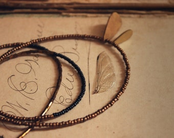 Isolde. Rustic BohoChic Hand Strung Beaded Vintage Brass and Glass Seed Bead Necklace.