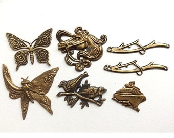Assorted Antiqued brass Stampings Butterfly, horse, branch, cruise ship, birds on a branch- You will receive all the charms in the photo