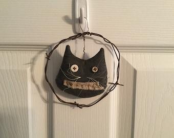 Primitive hanging cat