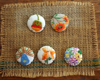 Brooch with floral motif made from repurposed embroidered linens