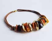 Vintage Chunky Plastic Necklace Made from Stacked Flat, Buttonlike Beads in Warm Colors - Strung on Multi-Strands of Brown Cotton Cord - 19""