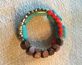 Turquoise, gold, brown, wood, and red wrap bracelet that can be worn several different ways.