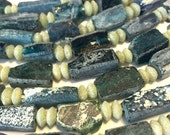 Ancient roman dark glass beads whole strand nugget style
