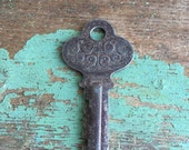 Antique Ornate repousse Flat Key 1920's scrolling design