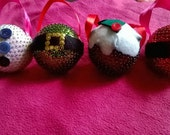 Set of four hand pinned baubles