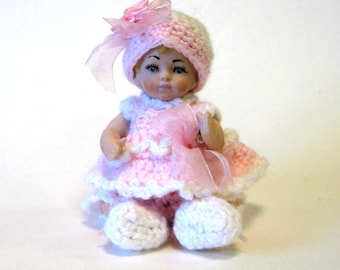"Doll little girl 5"" full porcelain cast from a vintage mold wearing a pink crocheted dress and hat"