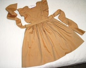 Easy Care Navy or Tan School Uniform in Pinafore Jumper style.  Sizes 12 months to 10.  Choice of colors.