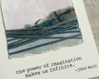 blue collaged landscape art card with john muir quote