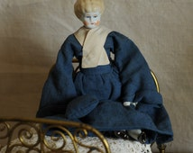 """8"""" china head doll, blond lowbrow with hand sewn blue dress and purse, pink cheeks"""