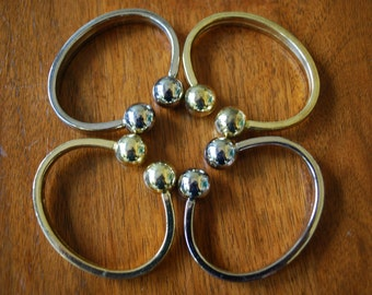 four napkin rings - mixed - gold and silver -  minimalist - modern