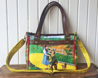 Dandelion Double Zip Handbag in Wizard of Oz with cross body strap and brown faux leather