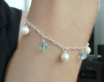 Bracelet of sterling silver, quality freshwater pearls, blue topaz gemstones, wedding, fine jewelry