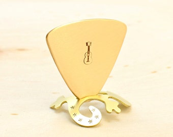Triangular bronze bass guitar pick with musical inspiration - GP994