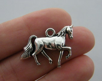 2 Horse charms antique silver tone A2