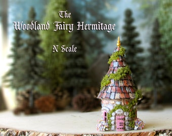 Woodland Fairy Hermitage of The Bewildering Pine - Miniature Round Cottage with Mossy Roof, Wooden Door, Golden Finial & Blooming Flowers