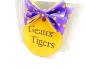 GEAUX Tigers wood ornament with purple and yellow polka dot ribbon