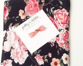 Baby girl swaddle blanket and headband set. Pretty black and coral floral with a matching leather  bow
