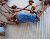 Knotted Brown Leather Wrap Bracelet with Carved Lapis Fish Bead