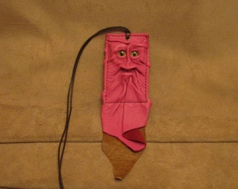 Grichels leather ID card holder - bubblegum pink with yellow slit pupil eyes, distressed caramel brown fringe