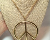 Vintage Large gold Tone Peace Sign on Gold Tone Chain.