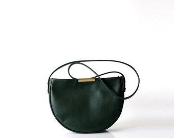 structured leather saddle bag OPELLE Meena Saddle minimalist leather bag in emerald