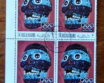 Vintage postal stamps Mosaic Skull with the Olympic symbol for art projects or scrapbooking or collection