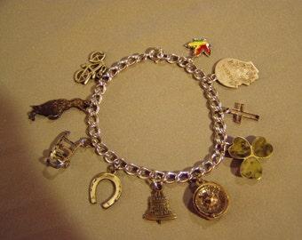 Vintage 1960s Sterling Silver Charm Bracelet 10 Charms Roulette Wheel Penguin Shamrock Handcart Maple Leaf 8361