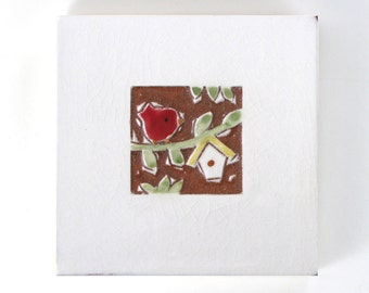 """Red Bird and Yellow Birdhouse, handmade ceramic tile, wall hanging or coaster 4""""x4"""""""