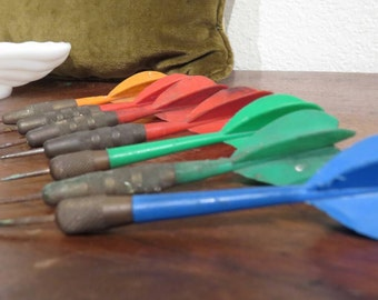 Set of vintage darts rainbow colored and brass