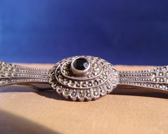 Art Deco Era Sterling and Marcasite Brooch with Faceted Onyx center