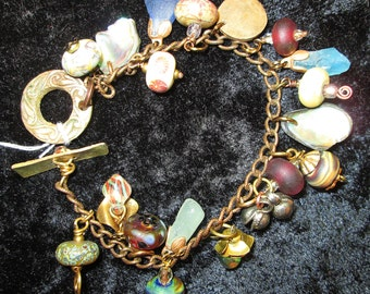 Bronze and lamp work Charm Bracelet