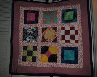 "25""x25"" machine quilted wall hanging"
