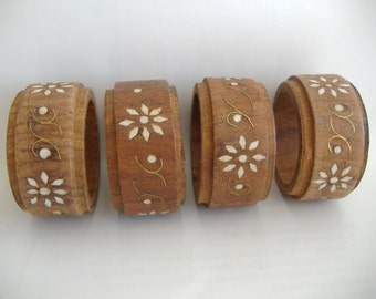 Four Wooden Napkin Rings with White Inlay