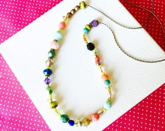 Colorful and Unique Glass Beaded Necklace. A beautiful selection of sparkling beads to enhance any outfit, any season. Can Customize