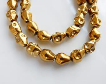 Gold  hematite skull beads (10x8mm)