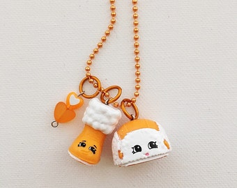 Shopkin Charm Necklace Season 3 Snug Ugg and Flappy Cap