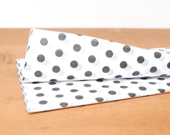 white tissue paper: black and white polka dot gift wrap, tissue, stuffing