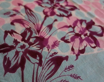 Mid century mod pink and teal bubbles in ball with maroon floral overlay