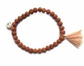 Bali Rudraksha bracelet with light brown tassel