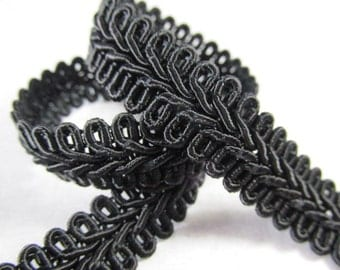 Black 1/2 inch or 13mm Romanesque Flat Gimp Trim sold by the yard