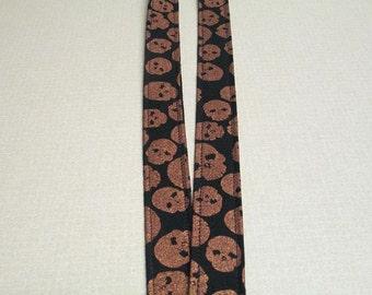 Fabric Lanyard, black with copper skulls