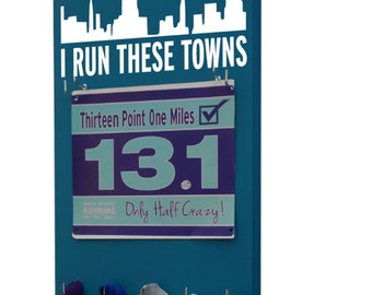 The Race Bibs Rack is your Answer to displaying Race Bibs Proudly - I run these towns - I run this town