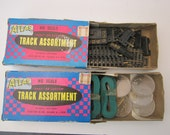 2 Boxes of Atlas HO Scale Snap Track and Other Unknown Model Train Parts and Wire