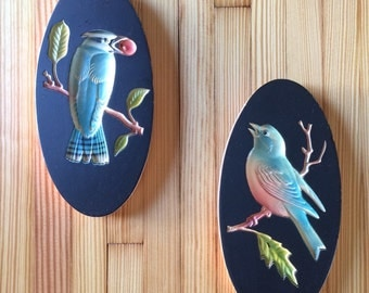 pair of vintage 3D bird wall hangings