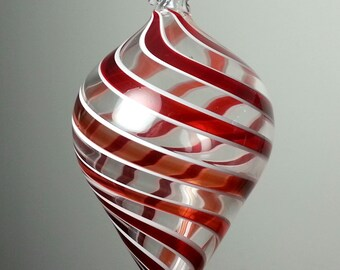 red and white swirled blown glass ornament