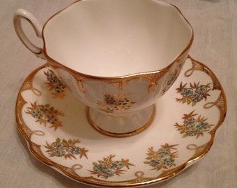Beautiful Vintage Crisp White Tea Cup and Saucer with Delicate Turquoise Flowers with Red Centers  Trimmed with Beautiful Ornate Gold Design