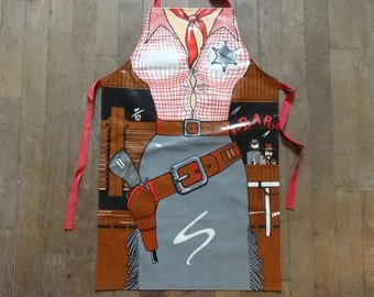 Vintage English Cotton Coated PVC Lady Sheriff Gunslinger Gun Apron Cooking Kitchen Collectable circa 1980's / English Shop