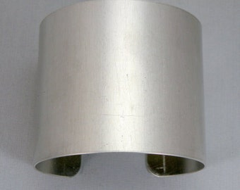 2 inches wide by six inches long, one dozen (12)Aluminum Cuff Bracelet Blanks